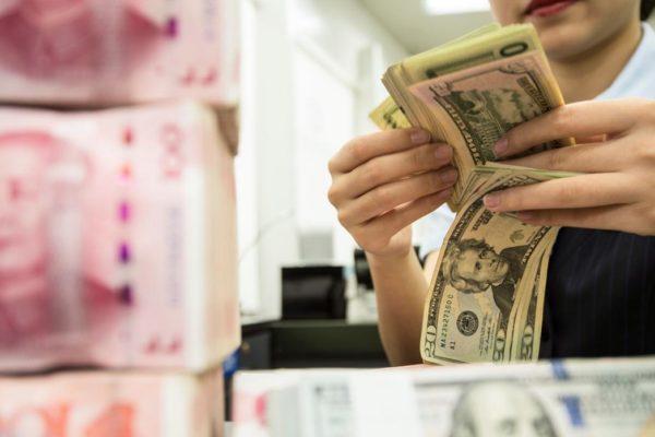Reservas chinas de divisas aumentan en junio a 3,1123 billones de dólares