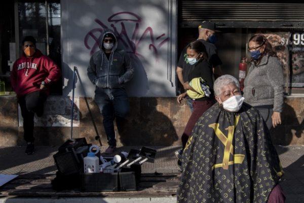Cientos de venezolanos montan campamento en Chile para presionar repatriación